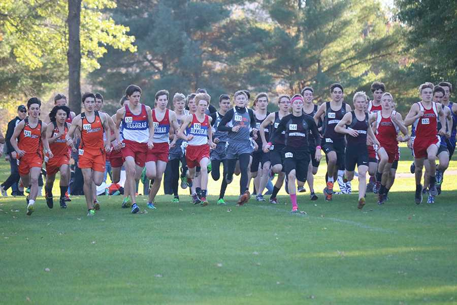 The boys' cross country team takes off at the beginning of the race.