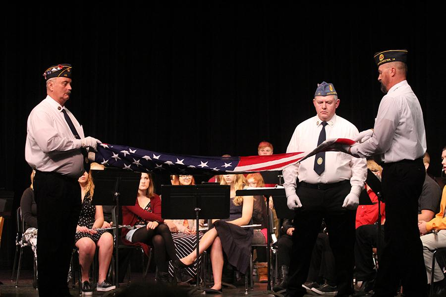 At the Veterans Day assembly in the Hanson Auditorium veterans demonstrate the flag folding ceremony.