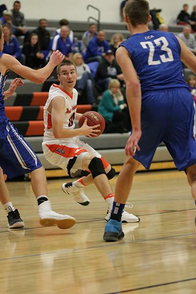 Senior Kyle Wright reads the defense while he powers into the lane. Wright averages 4.5 points per game.