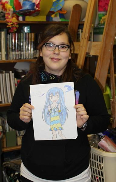 """Sophmore Rebecca Cole presents her drawing of Anime character Juvia Lockser from her favorite Anime series """"Fairy Tale""""."""