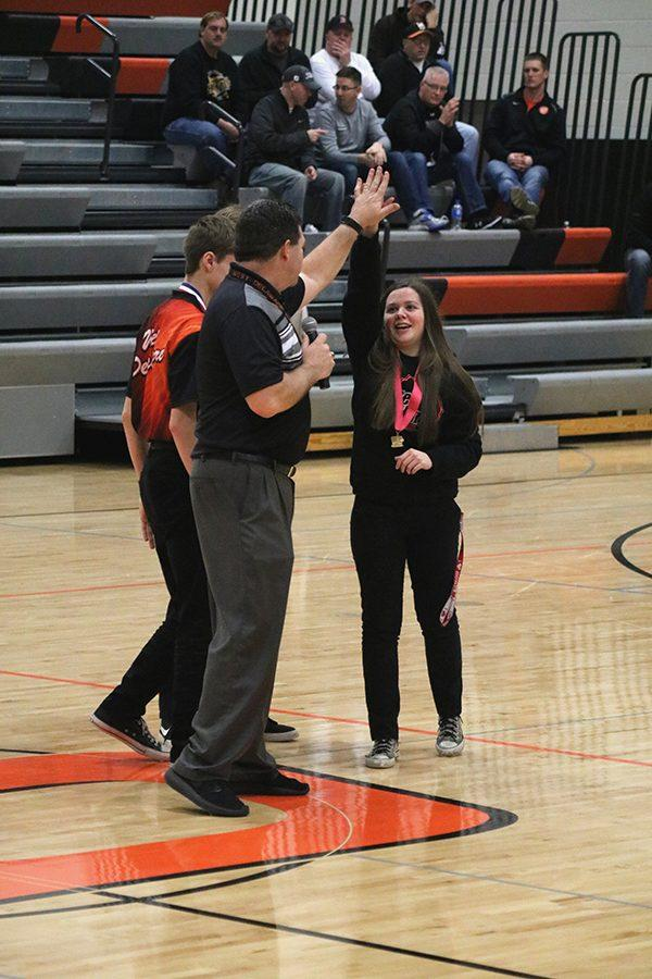 Junior Andrea Salow high fives Athletic Director Mike Morrison after finishing first for the second time at the State Bowling Tournament. Salow became the first person in West Delaware bowling history to earn a two-time state champion title. She bowled a two-game series of 441.