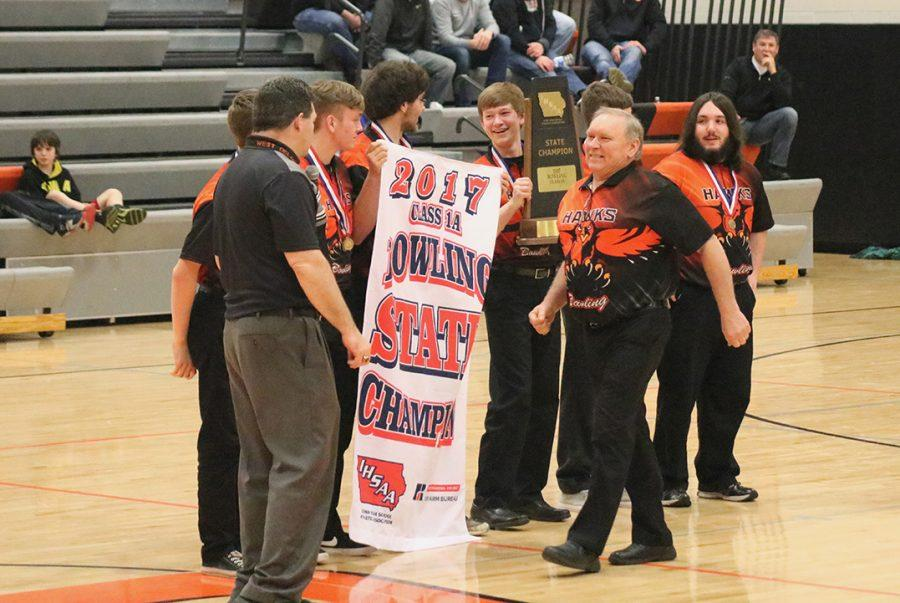 In+front+of+the+West+Delaware+crowd%2C+the+boys%E2%80%99+bowling+team+celebrates+their+State+Championship+victory.+The+boys%E2%80%99+beat+Maquoketa+by+52%2C+knocking+down+3%2C143+pins.+