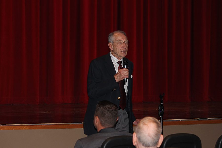 Senator Chuck Grassley speaks in front of the school. Grassley answered student and faculty questions about politics in Iowa and America.