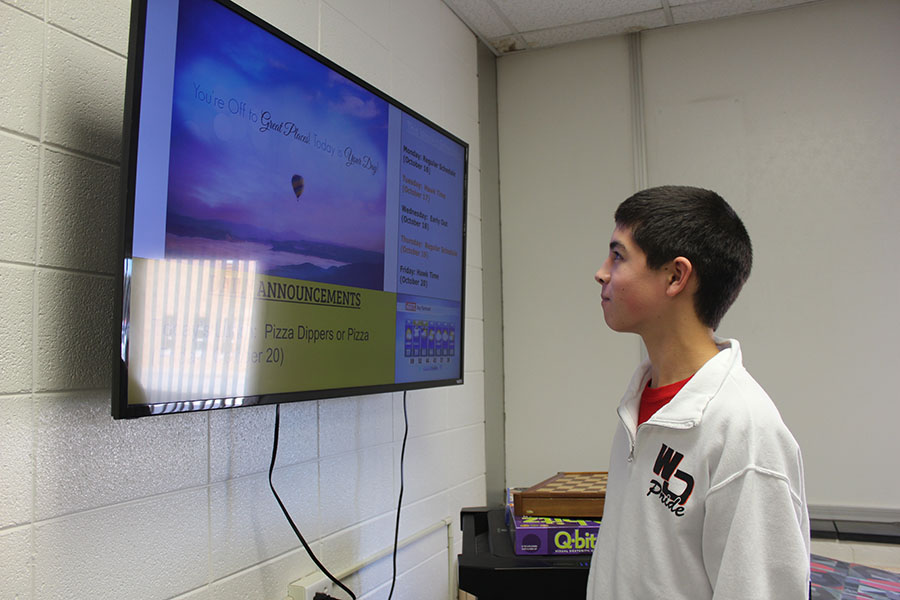Sophomore Matthew Salas checks the announcements for new information while in the library. The new TV sets allows students like Salas to revisit the announcements without opening an electronic device.