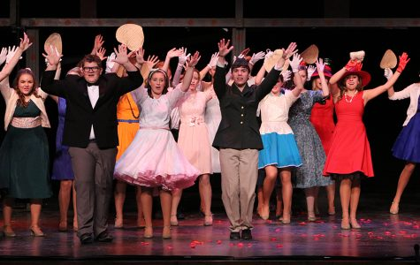 "The musical cast comes together to sing the song ""Burning Love"" at the end of the musical."