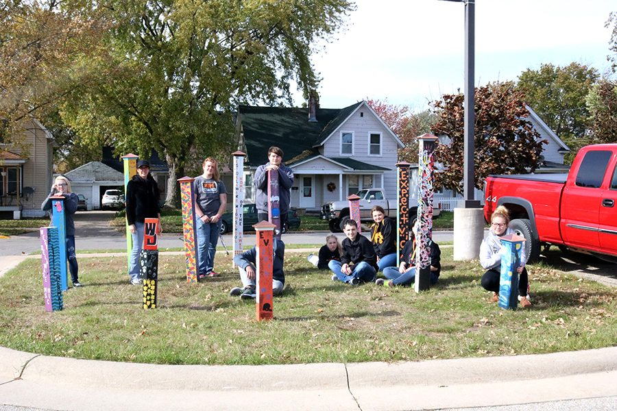 The posts were installed outside by the front parking lot. Some of the students who participated in this project stand by their posts: Tesia Manson (12), Joey Hughey (12), Jolene Pitzenberger-Timp, Myla Loecke (11), Ben Boeckenstedt, Devon Gardner (12), Dani Mundorf (12), Sydney McGraw (12), Keeshia Steffen (12).