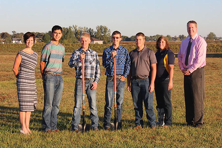Superintendent Dr. Kristen Ricky and Principal Tim Felderman look on as FFA advisor Tammy Schneiders and her students begin construction for their future barn on Sept. 29. From left to right: Ricky, Nathan Bishop (11), Jacob Kaiser (11), Josh Hilby (12), Kyle Steffen (11), Schneiders and Felderman.