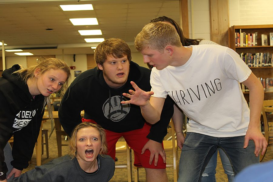 """Improv members Kelly Scherbring (12), Emily LaRosa (12), Adam Andregg (11), and Ben Litterer (12) act out an Improv in which they discover """"Grocery Heaven"""" staffed by Olivia Neuzil (11), playing as """"Hey-sus."""""""