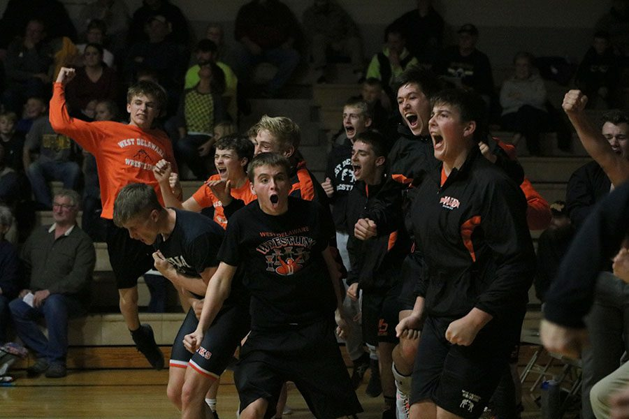 Celebrating+after+the+final+match%2C+the+Hawks+win+their+first+dual+of+the+season.+Five+out+of+the+seven+West+Delaware+wrestlers%2C+who+won+throughout+the+night%2C+ended+their+matches+in+pins.%0D%0A