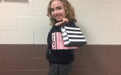 Grace Reiss (11) displays some of her shopping bags from Black Friday weekend.
