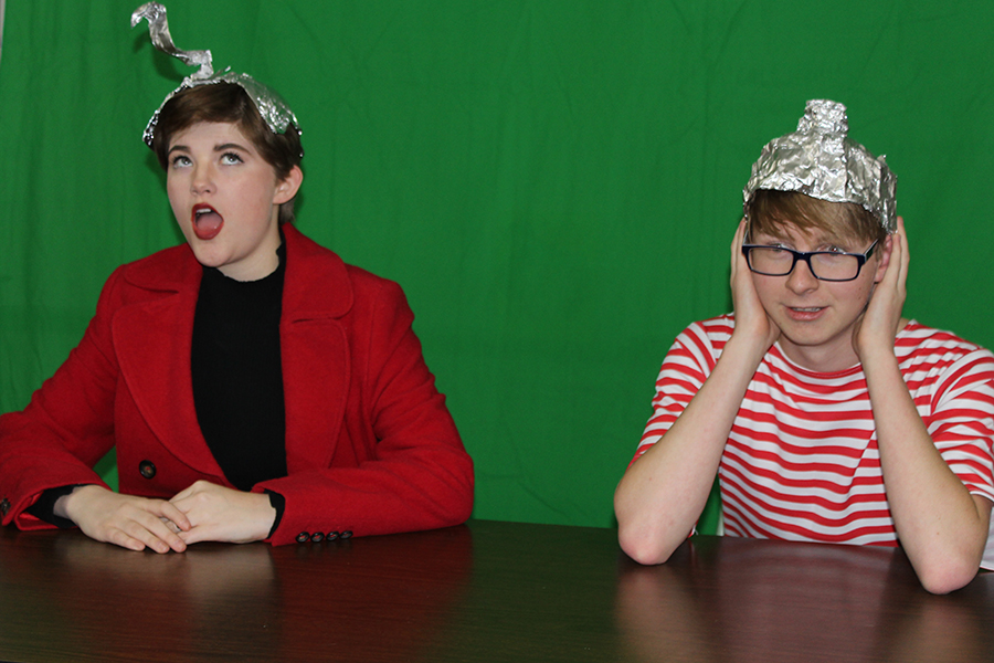 """Hope Straley (11) and Justin Miester (12) record their TV News broadcast called """"AWU"""" before the District contest."""