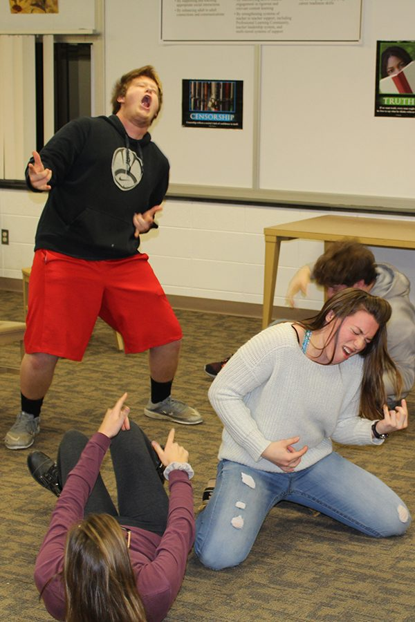 During a Group Improv practice, senior Aleah Vaske and juniors Adam Andregg and Olivia Neuzil pretend they are at a concert.