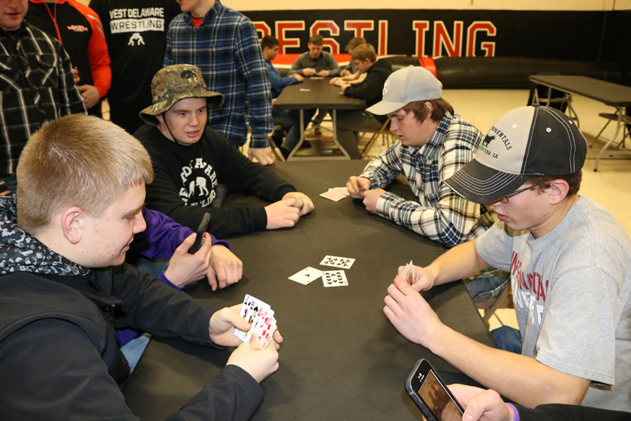 Juniors Spencer Kluesner and Kody Wenger play cards against seniors Adam Kelchen and Josh Hilby at the Highway 20 Dance.