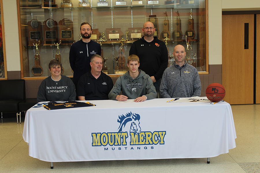 Tyler Kelley (12) signs to play basketball for Mount Mercy University next year.