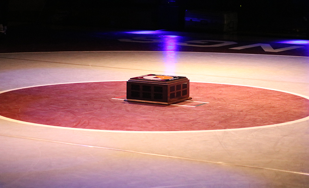 The Team Trophy was displayed under the spotlight, in the center of the mat before the dual begun.