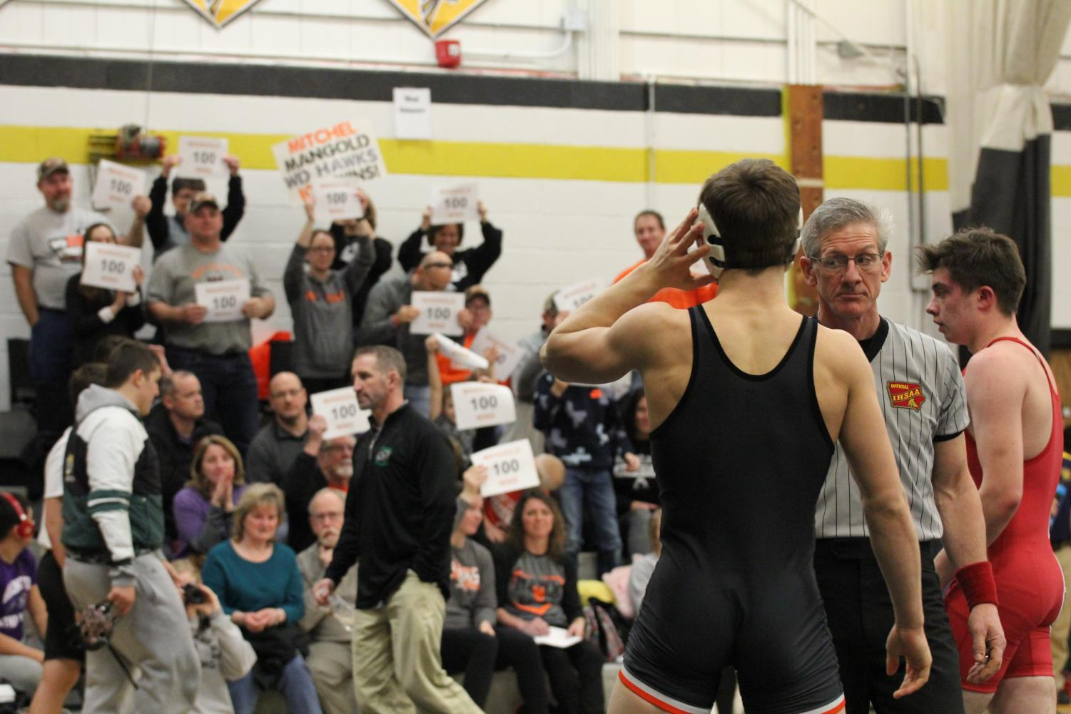 Mitchel Mangold looks to the crowd as he earns his 100th win at Louisa-Muscatine.