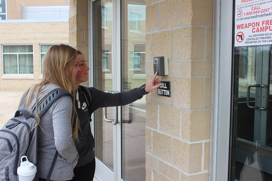 Seniors Kira Vaske and Rachel Haight use the buzzer to be let in during the school day.