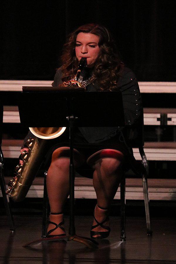 Olivia Neuzil (11) plays her saxophone in the Jazz Band.