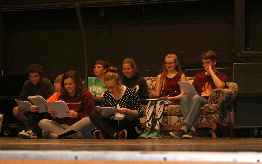 A group of cast members read