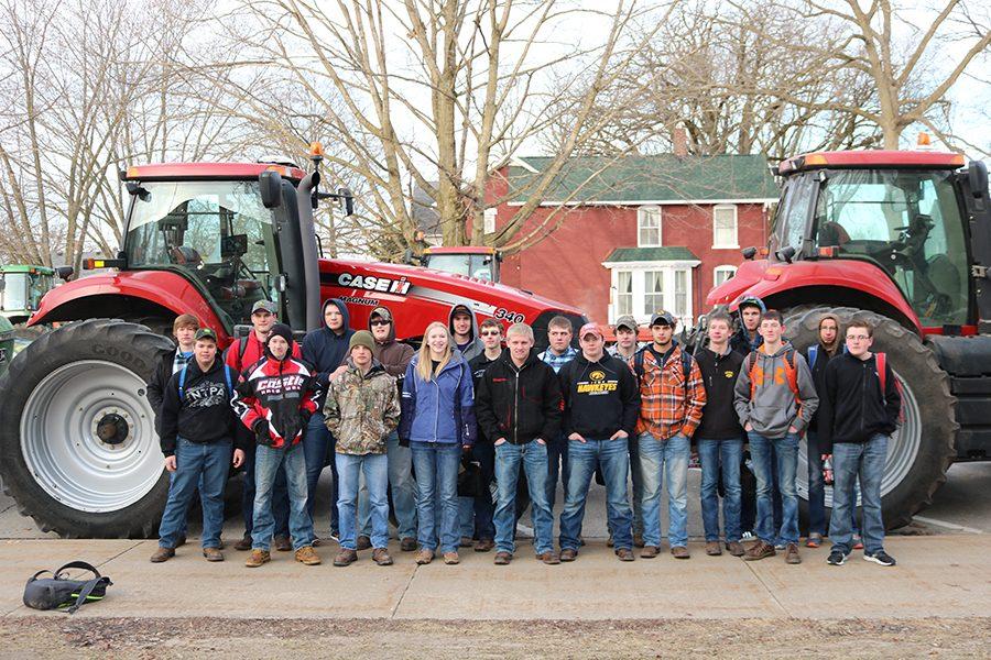 Eighteen students drove their tractors to school February 21 in celebration of FFA Week. Front Row: Kyle Steffen (11), Nathan Mangold (9), Brady Carroll (12), Georgie Hilby (11), Jacob Kaiser (11), Kody Wenger (11), Chad Bishop (10), Zach Goebel (10), Clayton Haight (10), Levi Mullis (10); Back Row: Jim Shover (12), Jim Drummy (11), Mitch Krogmann (9), Adam Andregg (11), Adam Monaghan (11), Josh Hilby (12), Spencer Hutchinson (11), Jeff Ilgen (11), Harrison Goebel (12), Kyle Deutmeyer (9).
