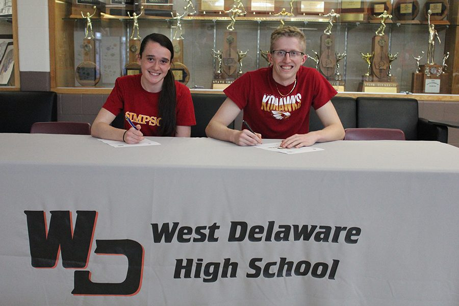 Seniors Abby Loecke and Cole Engel sign to run track and field in college.