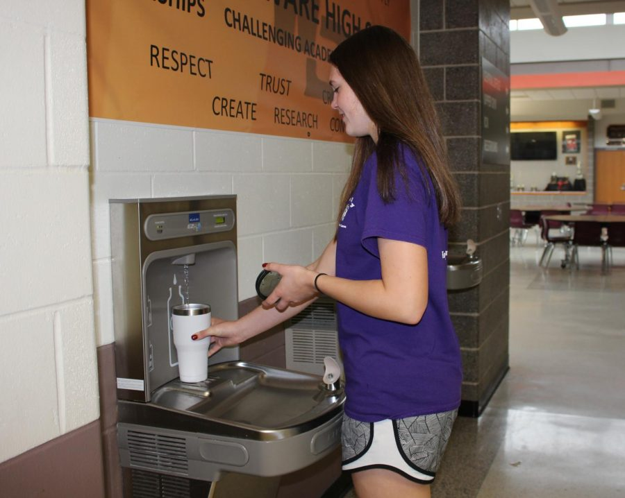 Tehya Demmer (11) uses the drinking fountain to fill her water bottle.