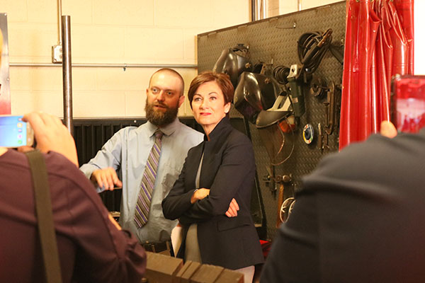 Welding teacher Seth Harms shows Governor Kim Reynolds the welding lab at West Delaware High School.