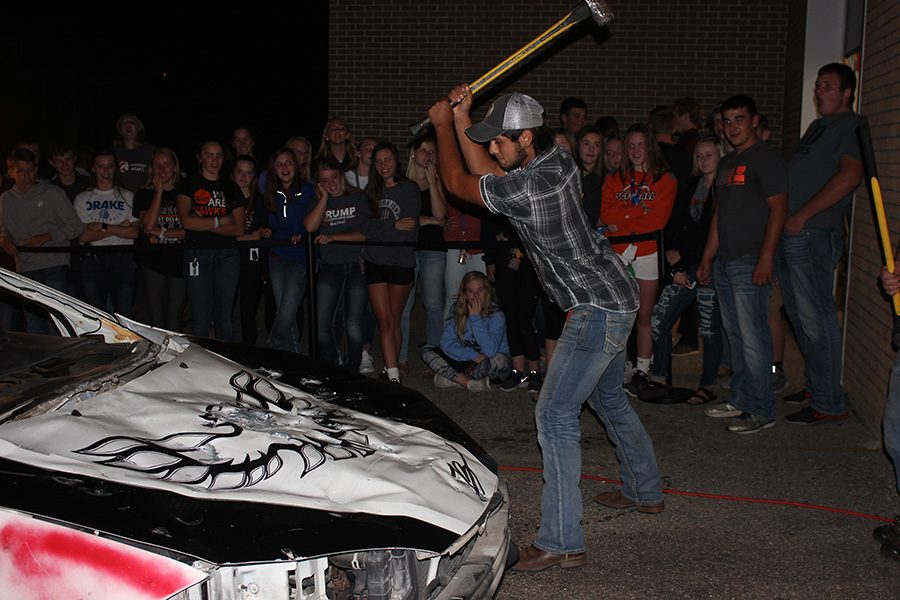 Chad Bishop (11) takes a swing at the annual Car Bash following Coronation. This year, the car was a Dodge Intrepid donated by teacher Jason Guyer's sister.