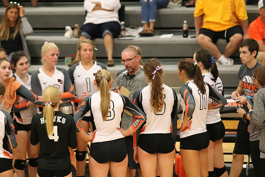West Delaware's volleyball team takes a time-out while playing Mount Vernon. Top Row: Paighton Lindauer (12), Megan McDonald (12), Leah Wegmann (11), Carlee Smith (9), Coach Brett Mather; Bottom Row: Ella Koloc (9), JoAnna Voss  (12), Macey Kleitsch (11), Kinley Kolbet (11), Allison Collier (11), Devon Gardener (12), Coach Shea Putz.