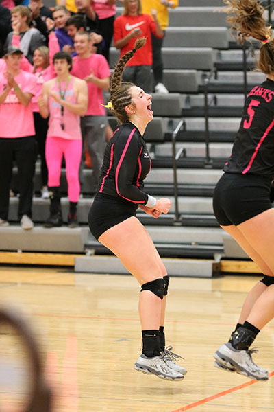 After+winning+the+game%2C+Paighton+Lindauer+%2812%29+celebrates.+Lindauer+finished+the+night+with+three+digs.
