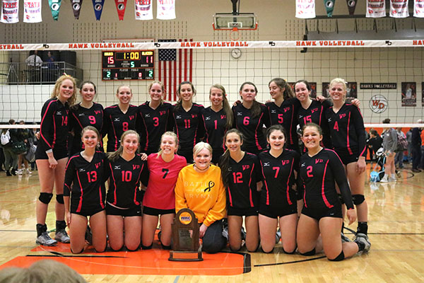 The+volleyball+team+poses+with+honoree+Brynn+Boeckenstedt+with+their+trophy.+All+of+the+proceeds+raised+went+to+the+Boeckenstedt+family.