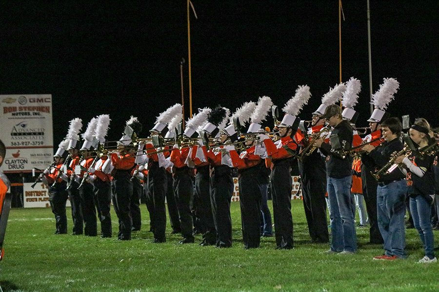 Oct.+22%2C+the+high+school+marching+band+is+joined+by+the+middle+school+in+their+performance+at+half-time.
