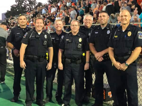 These seven police officers were the honorary captains at the football game, Sept. 14.