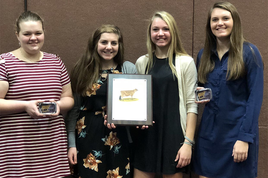 When given their award for high team in Jerseys, Madi Palmer (10), Amber Engelken (11), Laney Demmer (10), and Tehya Demmer (12), pose for a picture with their plaques. The girls worked as a group of four during the competition.