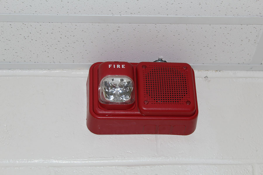 The fire alarm that detected the smoke from the classroom.