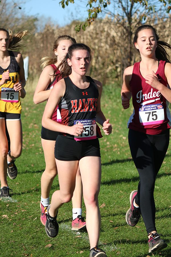 """On Oct. 18, Olivia Szymke (12) finishes the season at districts with a time of 25:02. """"It was my last year so my goal was to have fun with my teammates, improve as a runner, and get ready to run in college,"""" Szymke said."""