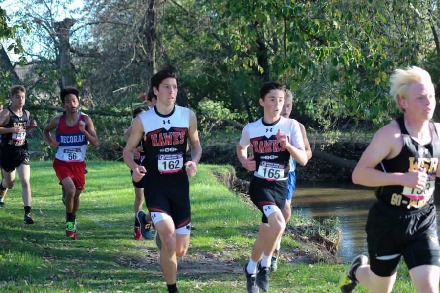 Teammates Nathan Goransan and Blake Smith work together and push each other at the district meet.