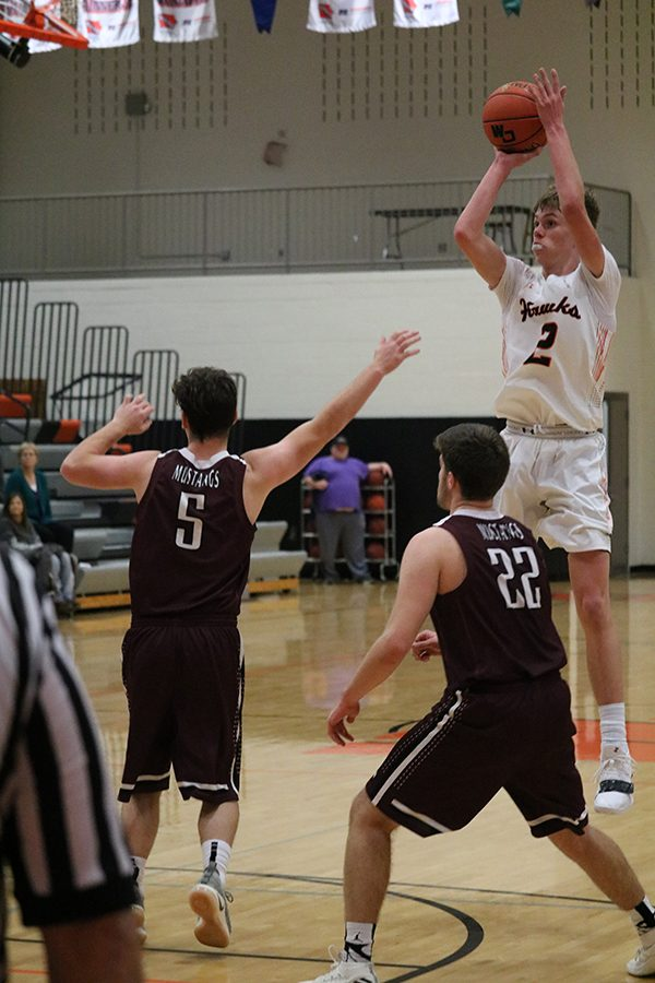 During the second game of the season, shooting guard Kyle Kelley takes a shot against the Independence defense. The Hawks won, 53-41, over Independence.