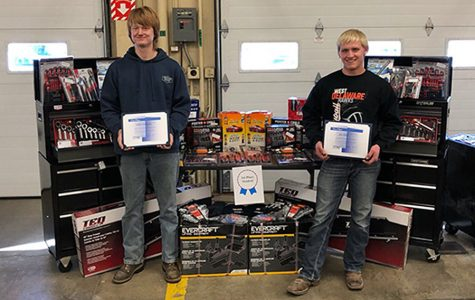 Jacob Kaiser and Dakota Limkemann pose for a picture with their awards after winning the state competition.
