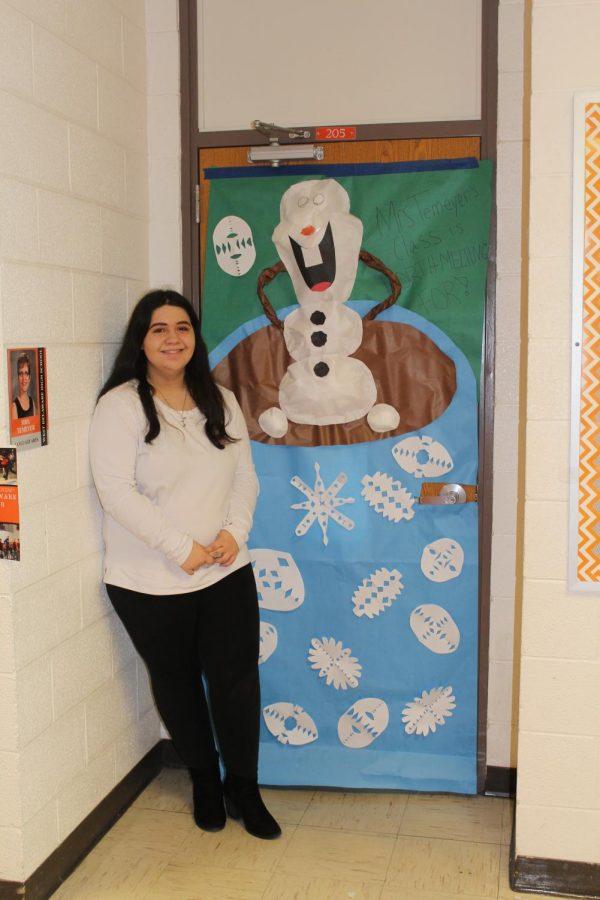 Sophomore Lanie Then poses in front of teacher Helen Temeyers finished homeroom door.