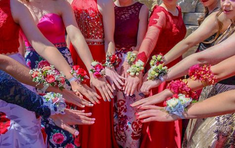 Students show off their corsages during prom pictures.
