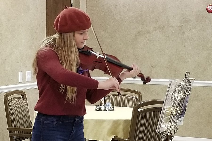 At+the+Window+Walk%2C+freshman+Gracie+McCusker+plays+her+violin.
