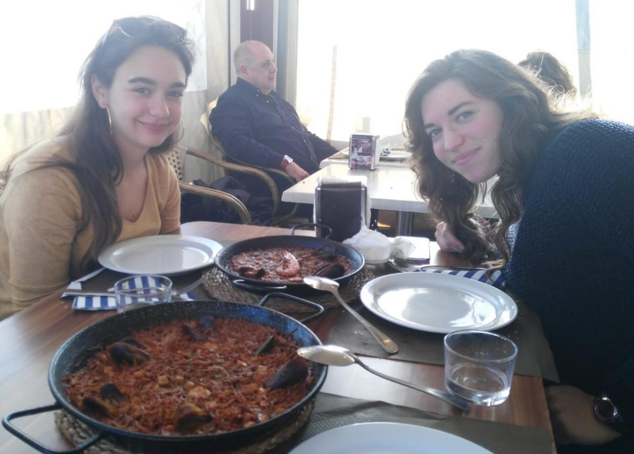 Waiting to eat a traditional Spanish meal, senior Olivia Neuzil and Laia López Rigol pose for a picture.