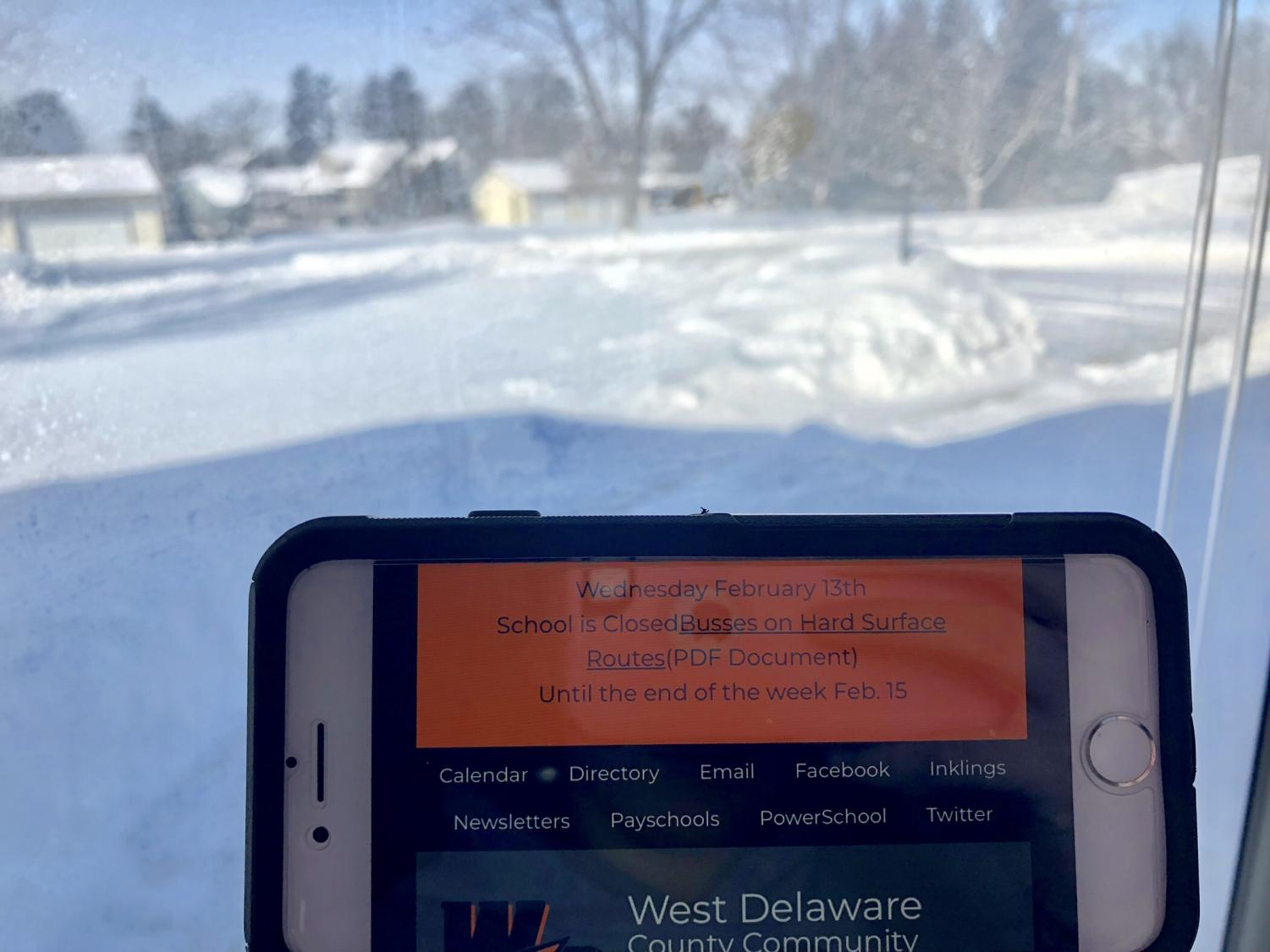 A phone displaying the message that school is closed Feb. 13, due to bad road conditions.