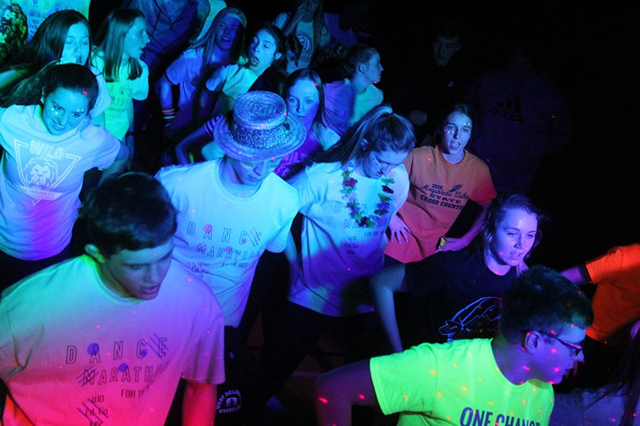 As the Loras students play music, students dance the