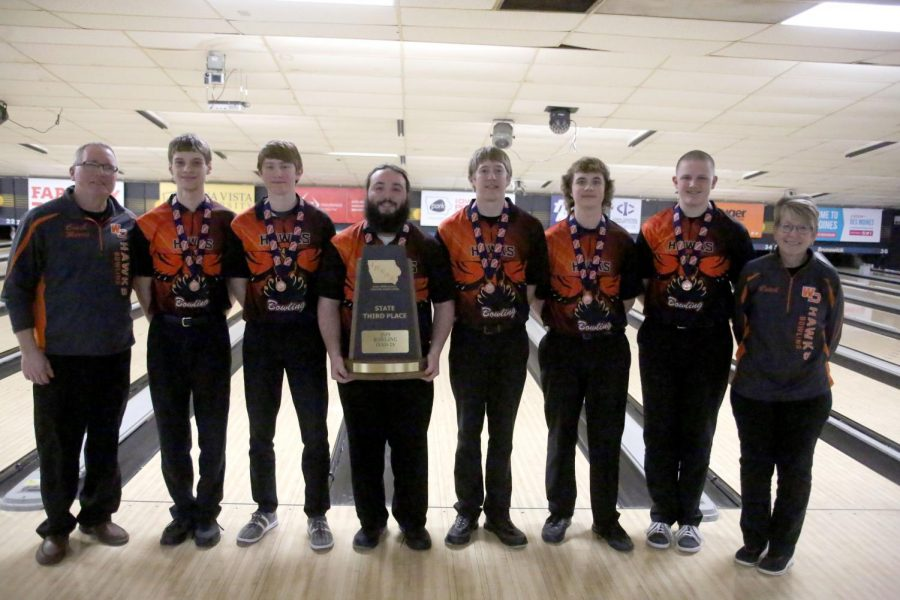 The boys' bowling team receives their third place trophy and medals at the state bowling tournament. Pictured: Coach Bob Morris, Alex Schnieders, Cole Turnis, Ian Tibbott, Brandon Larsen, Grant Schmidt, Eli Heims, and Coach Sue Morris.