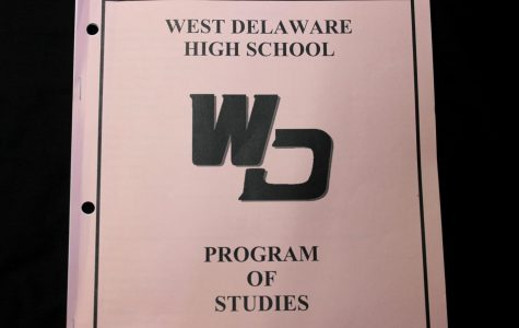 During course registration, students reference the West Delaware High School  Program of Studies.