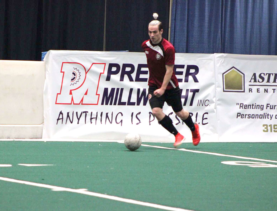 At the US Cellular Center in Cedar Rapids, Kaelen MacDonald plays on the indoor coed AYSO (American Youth Soccer Organization) club team from Cedar Rapids.