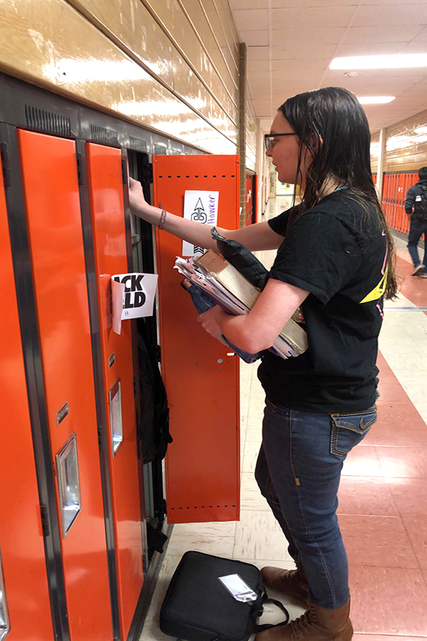 Junior Kamille Hawker stops by her locker in the morning before first hour to switch out her school materials.