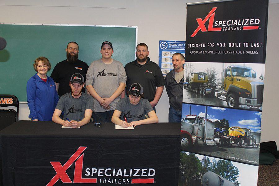 Junior Reed Northburg, senior Dakota Waterhouse, and senior Jeff Ilgen sign with XL Specialized Trailers.